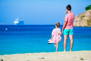 Happy of father and daughter on beach look on horizon