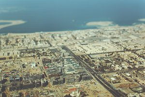 tilt shift, buildings, highways, sea