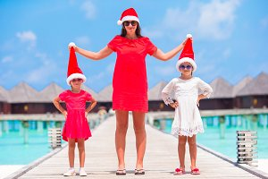 Fmily in red Santa hat on Christmas holidays