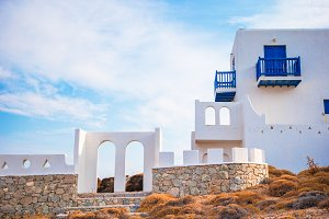 Traditional house with blue doors and windows on Mykonos, Greece.