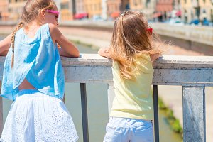 Little adorable girls taking selfie in Pisa, Italy. Photo about european vacation