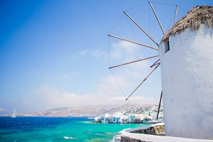 Famous view of traditional greek windmills on Mykonos island at sunrise, Cyclades, Greece