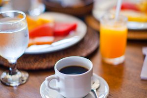 Delicious tasty coffee and fresh juice for breakfast at outdoor cafe