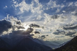 Sunrays penetrating Mountains & Town