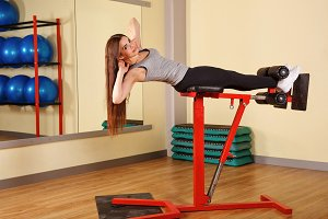 Girl exercises for abdominal muscles