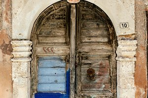 Closed arch door of old Greek house - Chania, Crete Island, Greece