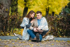 Young couple at the park in autumn season