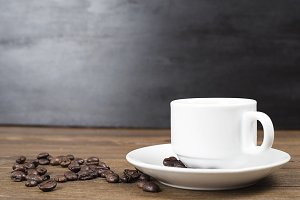 Composition of coffee cup with coffee beans