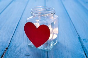 Glass jug with a red heart