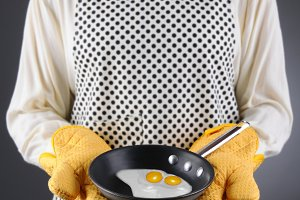 Homemaker Holding Pan with Fried Egg
