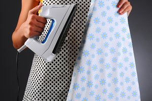 Housewife With Iron Ironing Board