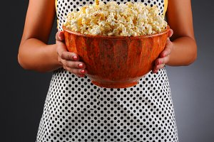 Homemaker Holding a Bowl of Popcorn