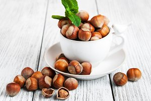 Cup with hazelnuts