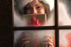 Girl in Window with Christmas Gift