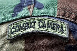 Close-up of Combat Camera army patch on a camo uniform
