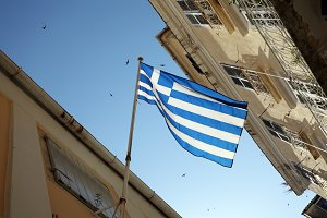 Greek National Flag at the street of Kerkira Town, Corfu Island, Greece
