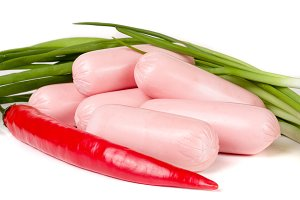 sausages with green onions and chilli isolated on white background closeup