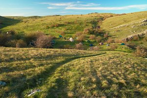 Tent camp in the hills and blue sky