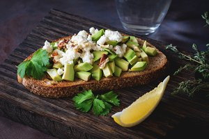 Avocado, cheese and walnut toast