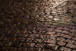 cobblestone street at rainy night