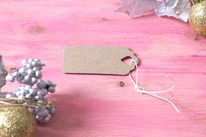 Pink christmas background with silver branch and label