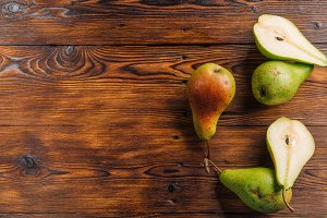 Fresh pears on the wooden background