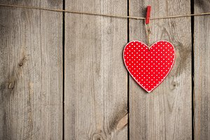 Red heart hanging on the clothesline for Valentine Day