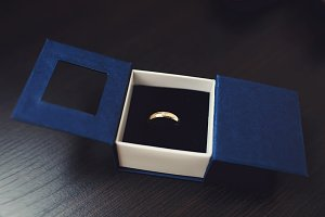 Wedding ring in a simple blue box