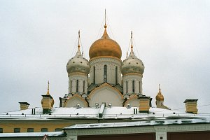 Domes of Zachatyevskiy Monastery (Conception Convent) over city roofs, Moscow, Russia - December 03, 2016 - 35mm film scan