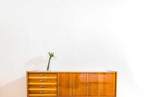 Flower on wooden sideboard