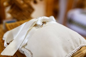 Wedding rings lie on a pillow