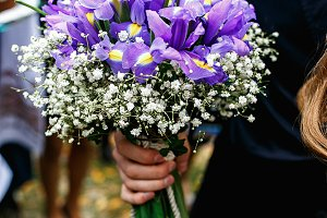 Man holds a wedding bouquet