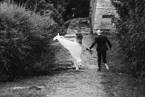 Bride spreads around her dress