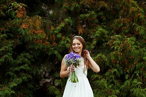 Pretty bride with a bouquet