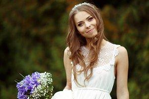 Bride smiles holding a bouquet