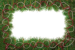 Christmas frame made of fir branches decorated with beads isolated on white background