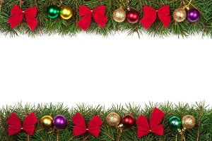 Christmas frame made of fir branches decorated with balls and red bows isolated on white background