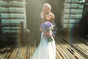Sun shines above a wedding couple