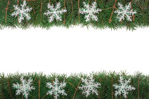 Christmas frame made of fir branches decorated with snowflakes isolated on white background