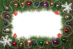 Christmas frame made of fir branches decorated with balls isolated on white background