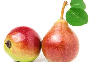 Two red pears with leaf isolated on white background