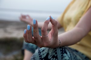 hand of a woman meditating in a yoga