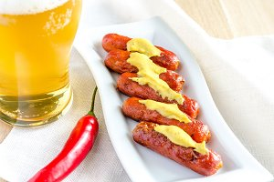 Roasted sausages with glass of beer
