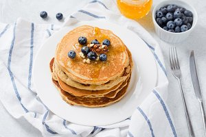 Pancakes with blueberry and honey
