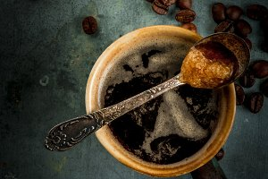 Coffee cup with beans and sugar