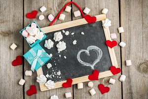 Love and Valentine Day decoration with hearts, frame, gift box