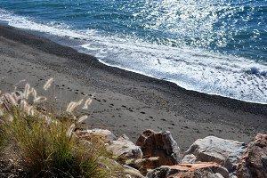 rocks, footprints and sea
