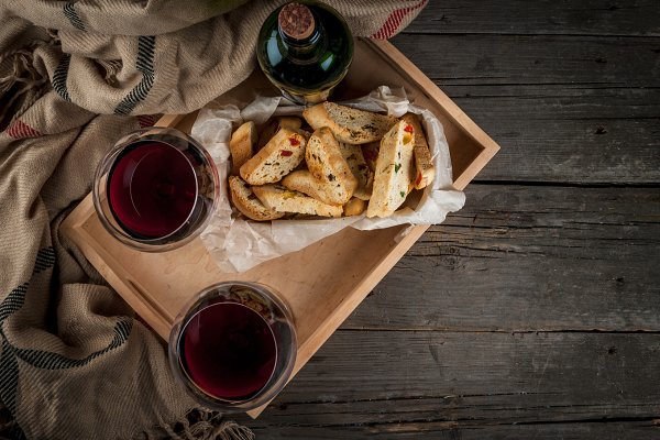 Tray with wine and pastries