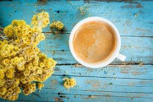 Coffee mug with dried wildflowers