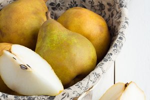 yellow pears on a white table